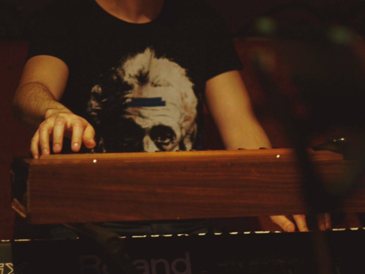 Mid Section Of A Man Playing The Keyboard
