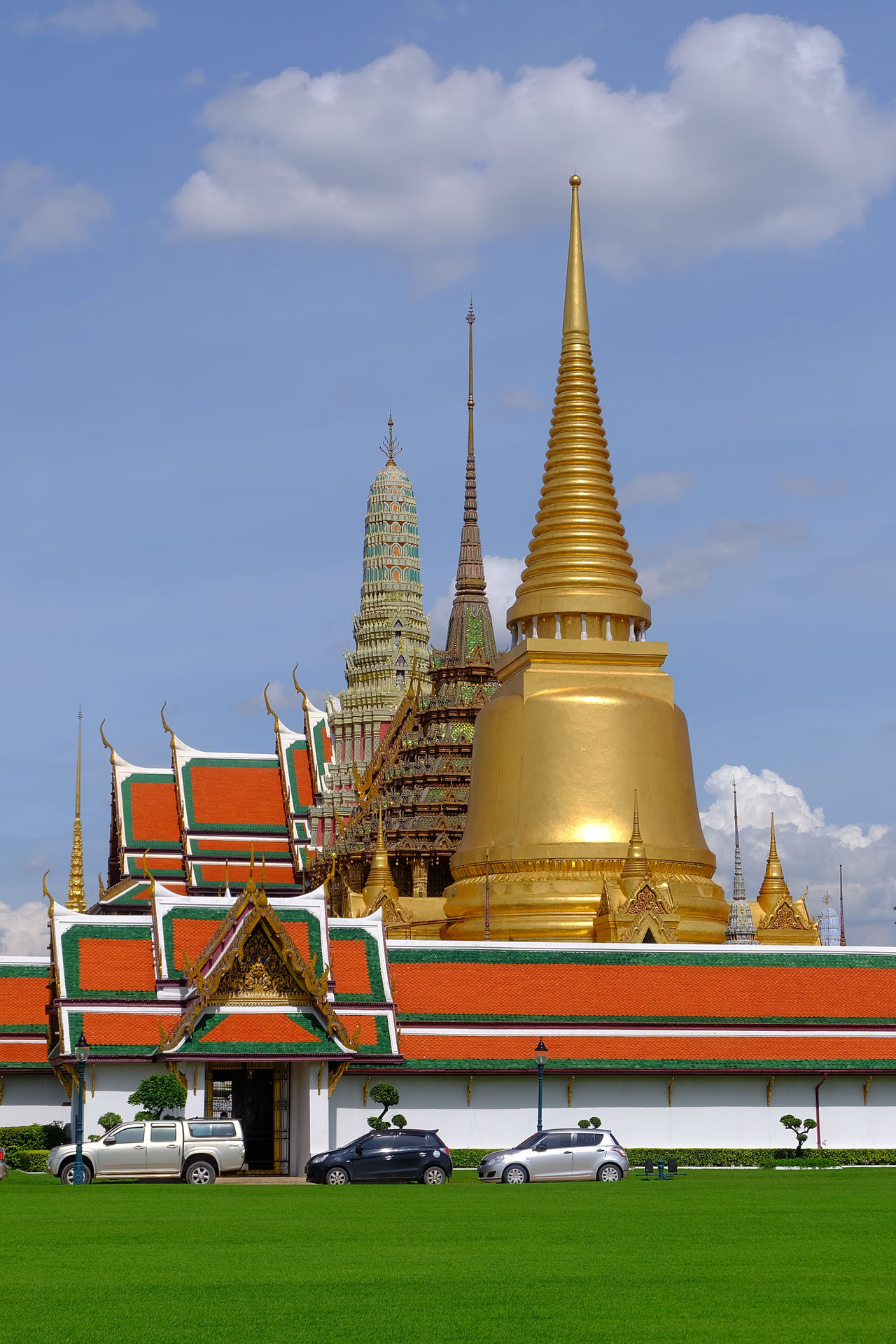 Wat Phra Kaeo temple , landmark of Thailand Ancient Architecture Art Blue Blue Sky Bluesky Building Cloud Grass Green Greensward History Landmark Landscape Old Pagoda Religion Royal Royal Palace Sky Temple Thai Architecture Thai Art Tree Wat Phra Kaeo