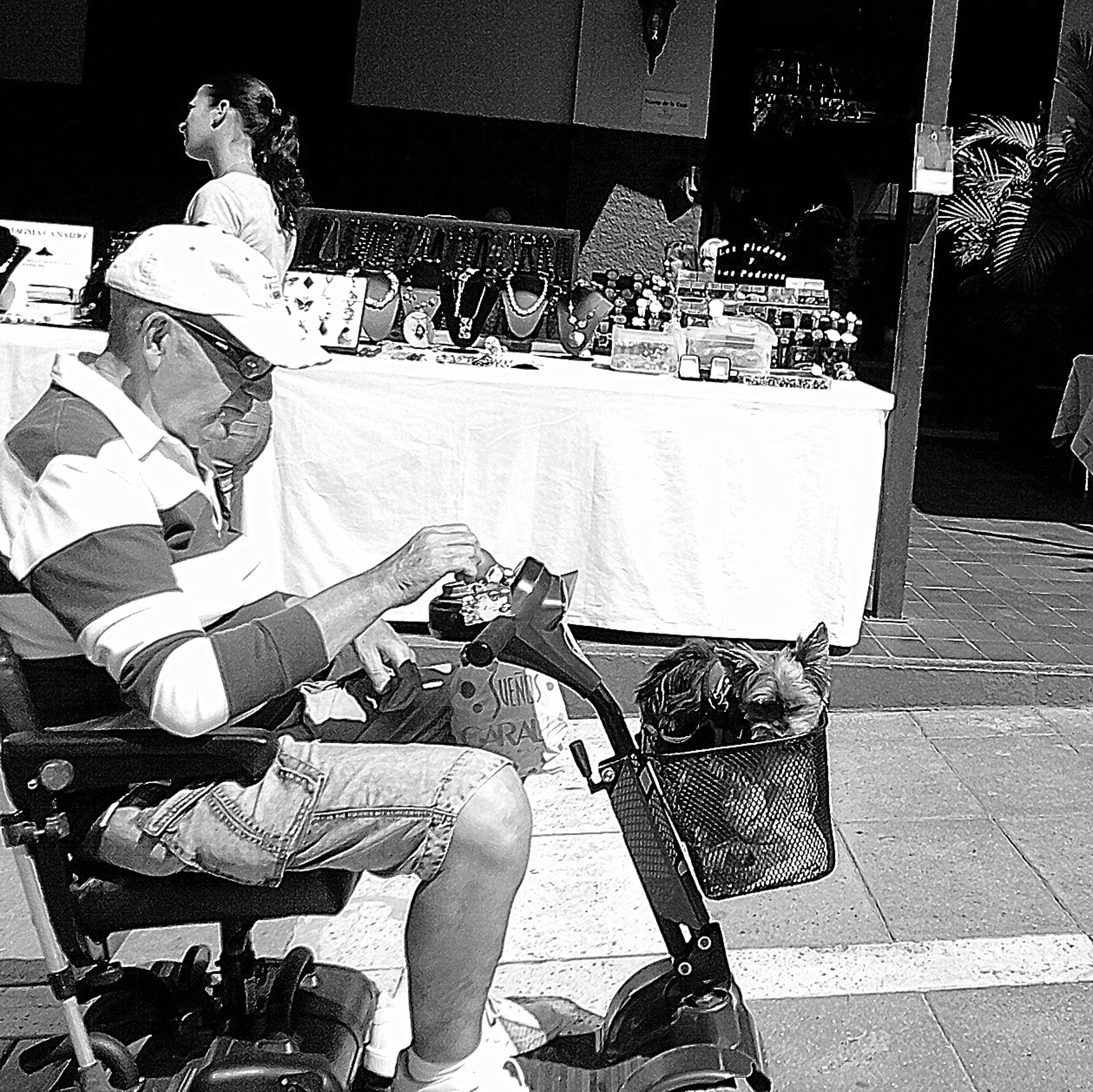 men, market, lifestyles, person, retail, chair, sitting, street, building exterior, for sale, leisure activity, market stall, casual clothing, high angle view, sidewalk cafe, food and drink, food, shopping, street market