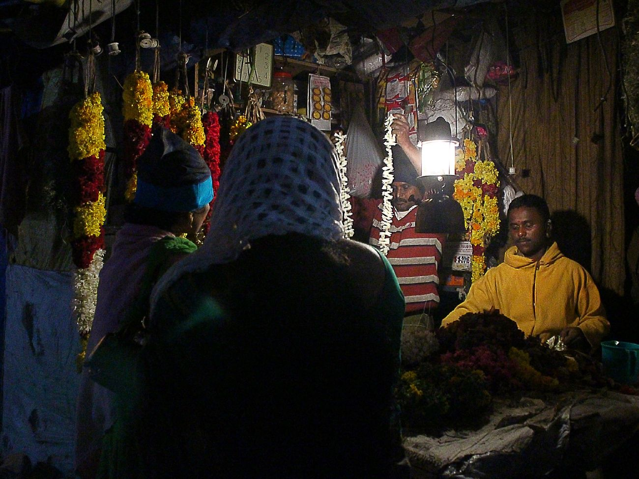 Telling Stories Differently India flowers florist occupation people random colors First Eyeem Photo Indian Florist Random Workers Everyday People Indian Culture  Nightworker Flowers Occupation Colors