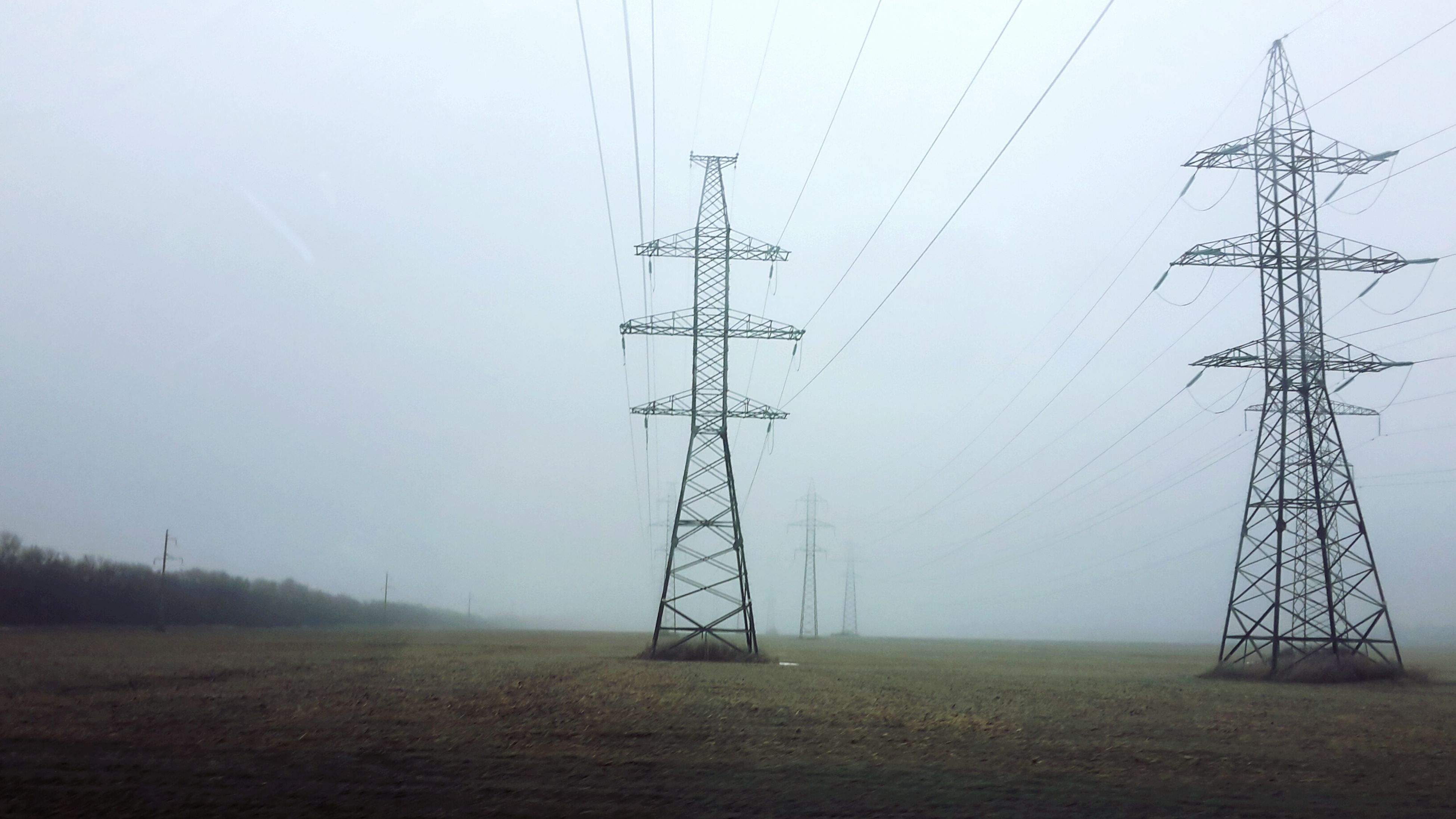 electricity pylon, power line, electricity, power supply, fuel and power generation, connection, technology, cable, clear sky, field, landscape, power cable, tranquility, nature, sky, electricity tower, tranquil scene, outdoors, no people, weather