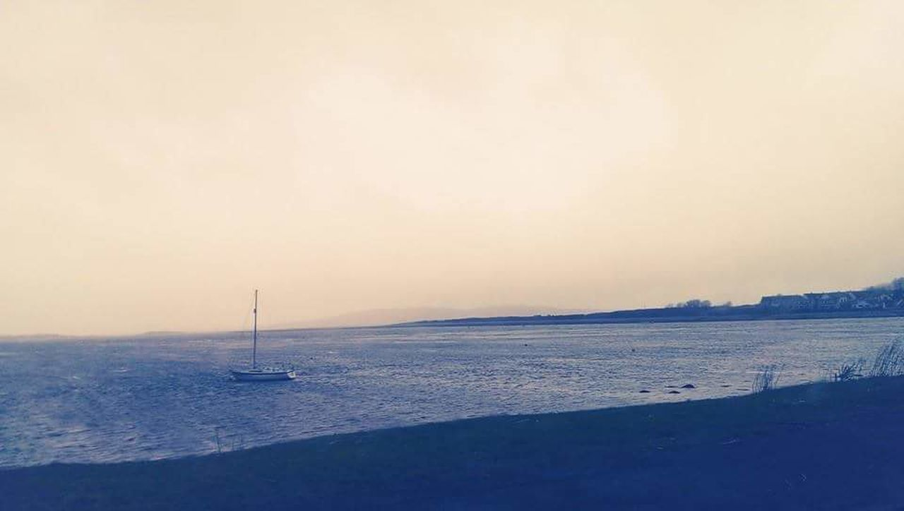 sea, nautical vessel, water, sunset, nature, beauty in nature, beach, sailboat, scenics, tranquility, tranquil scene, outdoors, no people, sky, sailing ship, transportation, sand, yacht, winter, mast, sailing, travel destinations, cold temperature, horizon over water, snow, day, yachting