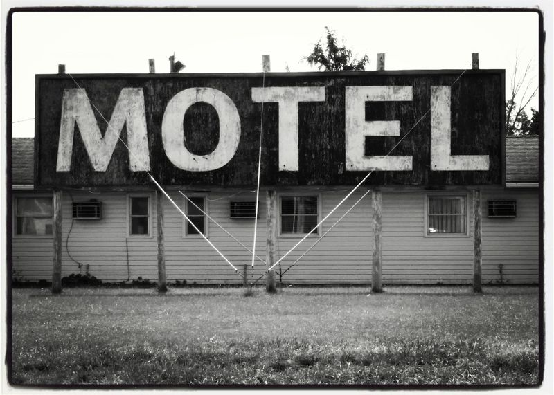 Text Outdoors Abstract EyeEmNewHere Built Structure Architecture Sign Motel Sign Building Exterior Grass Day No People