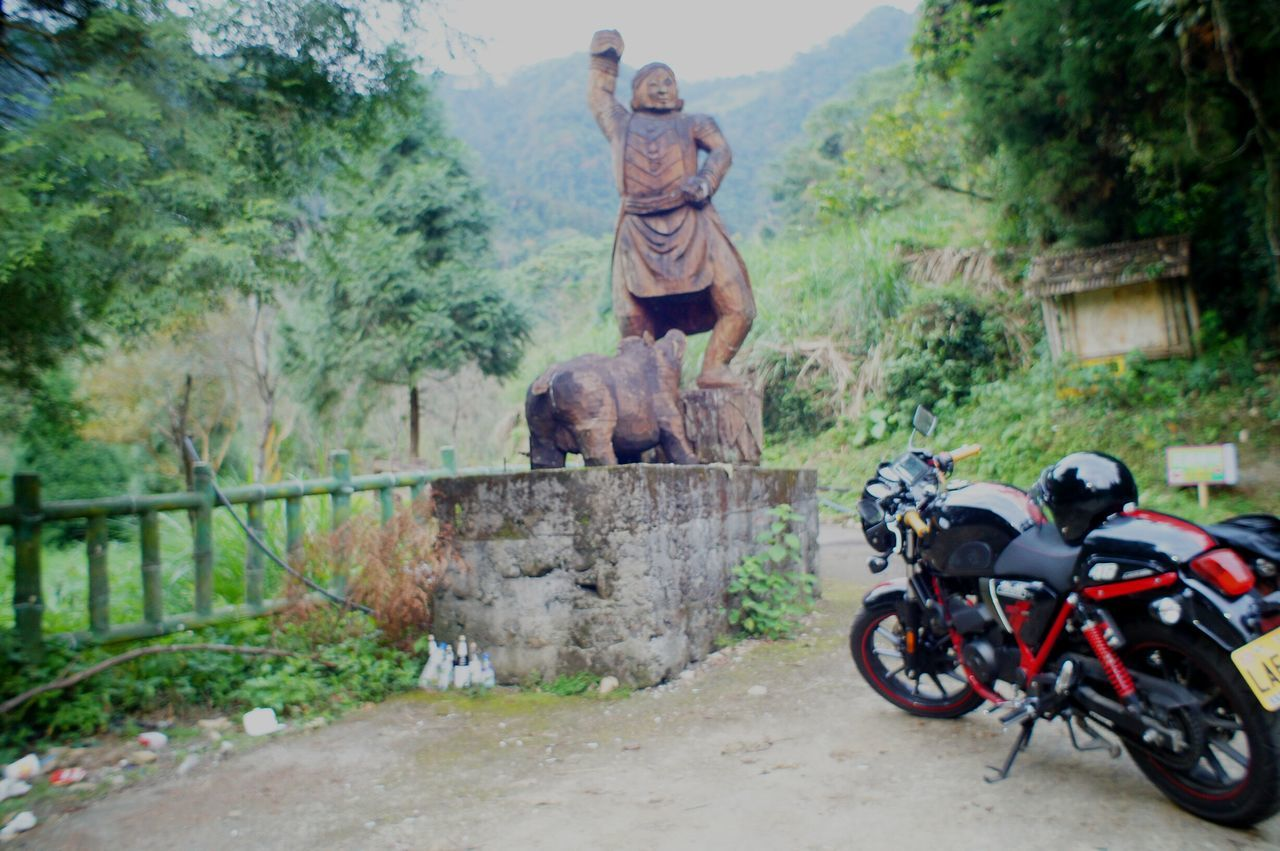day, outdoors, transportation, motorcycle, statue, tree, no people, sculpture, nature, sky