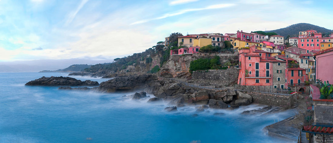 Panorama of fishing village - Tellaro ( La Spezia ) - Ligurian sea - Italy La Spezia Tellaro Liguria Italy Architecture Beauty In Nature Building Exterior Built Structure Cloud - Sky Coast Colorful Fishing Liguria Ligurian Sea Long Exposure Motion Mountain Nature Old Power In Nature Scenics Sea Sky Tellaro Village Water Waterfront