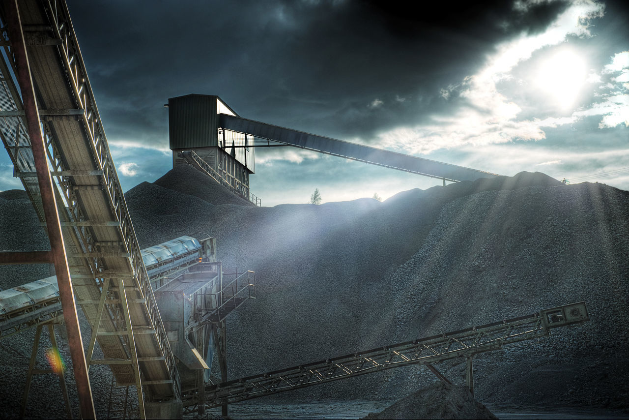 A gravel plant near Jessheim, Norway. (This location/site does not exist no more) Built Structure Cloud - Sky Factory Gravel Gravel Plant Gritty Industry Light And Shadow No People Outdoors Sunrays