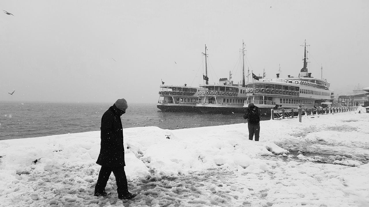 Outdoors Sea People Men City Streetphotography Istanbul Turkey Istanbul Turkey Blackandwhite Monochrome Bw Haliç Goldenhorn Snow Ferry Bnw Street Photography Black And White Snow Day Istanbuldayasam Istanbul City Photography Eminönü Eminönü/ İstanbul