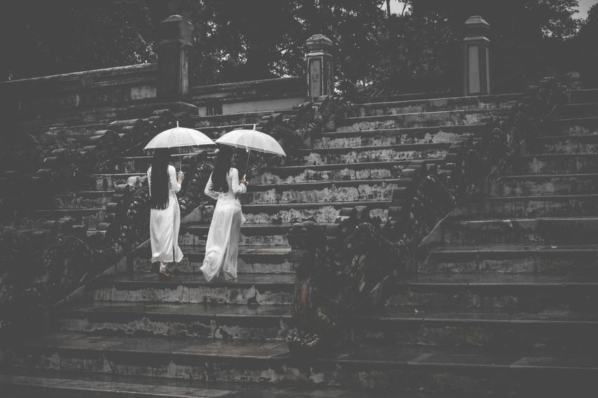 2 Women Ao Dai Vietnam Architecture Back And White Day Full Length Leisure Activity Lifestyles Men Outdoors People Rainy Day Real People Staircase Steps Steps And Staircases Togetherness Two People Umbrella Under Walking Women Young Adult The Week On EyeEm EyeEmNewHere EyeEmNewHere
