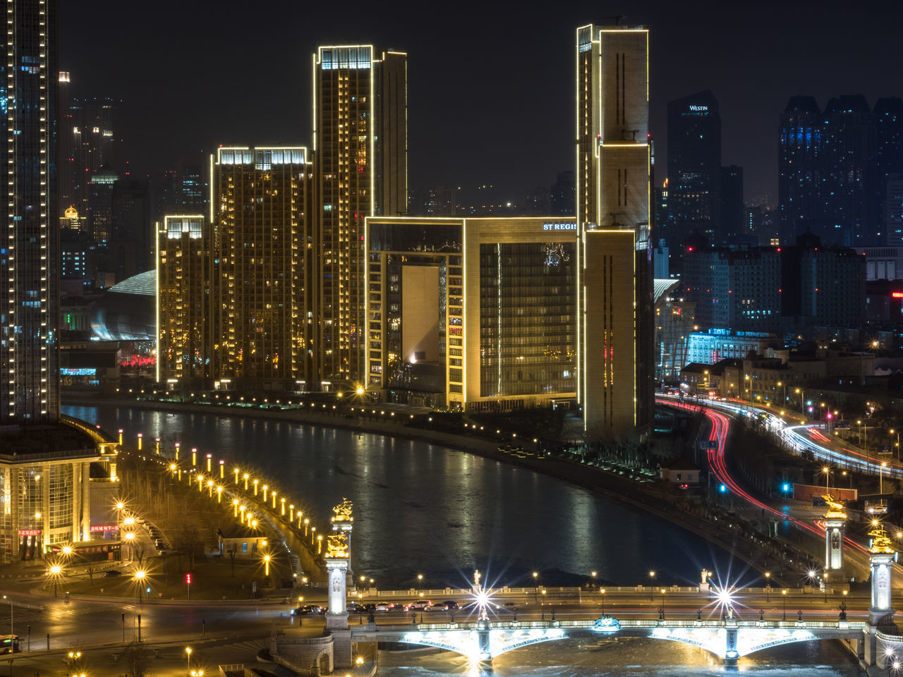 St. Regis Tianjin hotel next to 海河 Haihe river. Aerial Aerial Shot Aerial View Architecture Building Exterior China City City Lights Cityscape Cityscape Hotel Long Exposure M.Zuiko 45mm 1:1,8 Modern Architecture Night Olympus OM-D E-M5 Mk.II River Skyscraper Slow Shutter St. Regis Still Life Tianjin Travel Destinations Travel Photography Urban Skyline