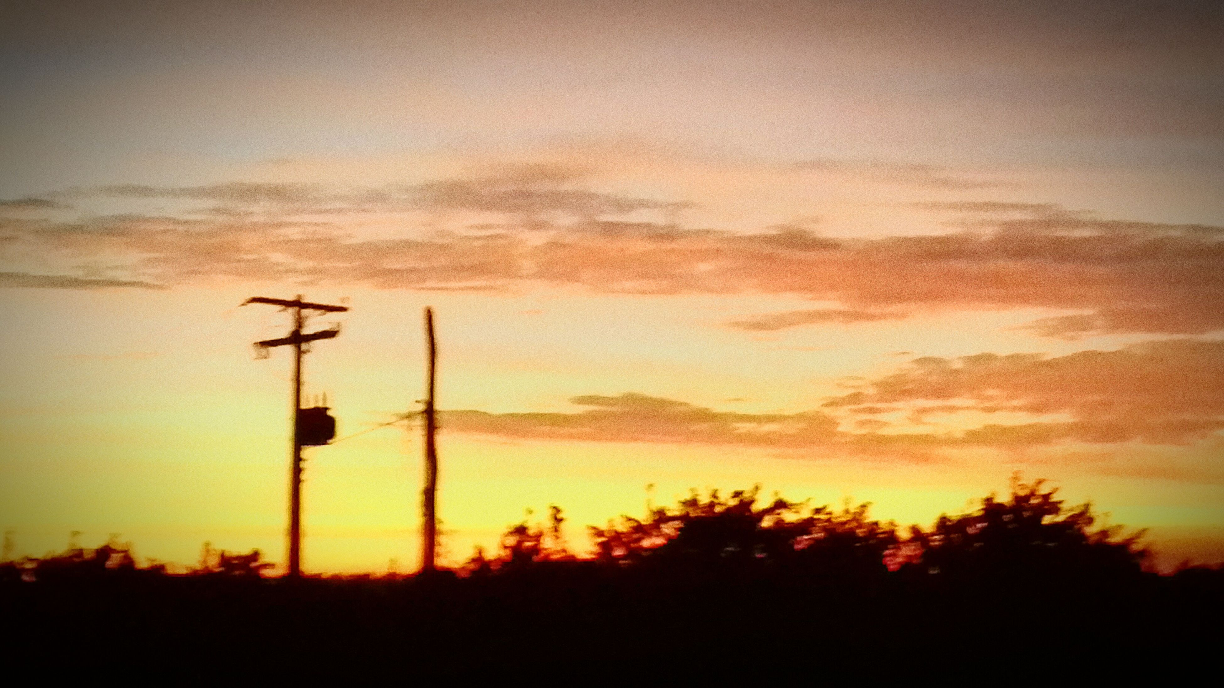 sunset, silhouette, orange color, scenics, tranquility, beauty in nature, tranquil scene, sky, nature, tree, landscape, idyllic, fuel and power generation, electricity pylon, technology, dramatic sky, outdoors, electricity, outline, field