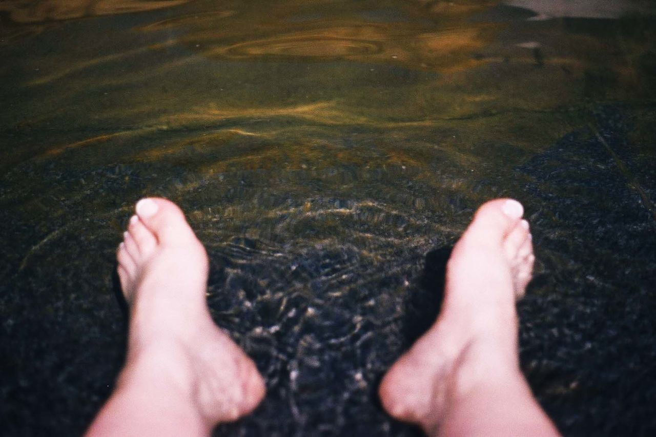 real people, one person, water, high angle view, human body part, barefoot, low section, day, human leg, close-up, human hand, lifestyles, outdoors, men, nature