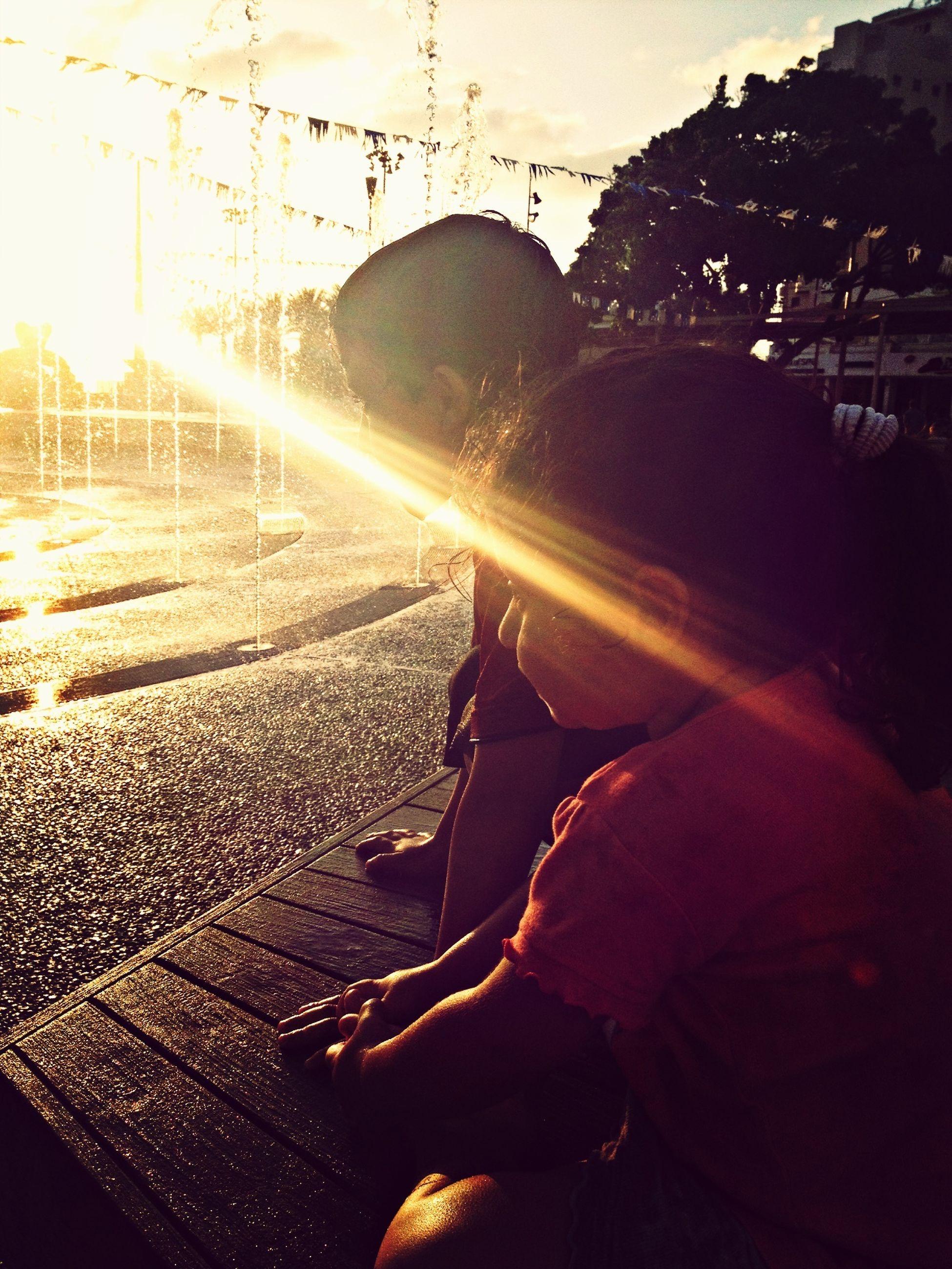 lifestyles, men, sunbeam, leisure activity, sunlight, transportation, sun, lens flare, mode of transport, sunset, land vehicle, car, rear view, silhouette, street, person, travel