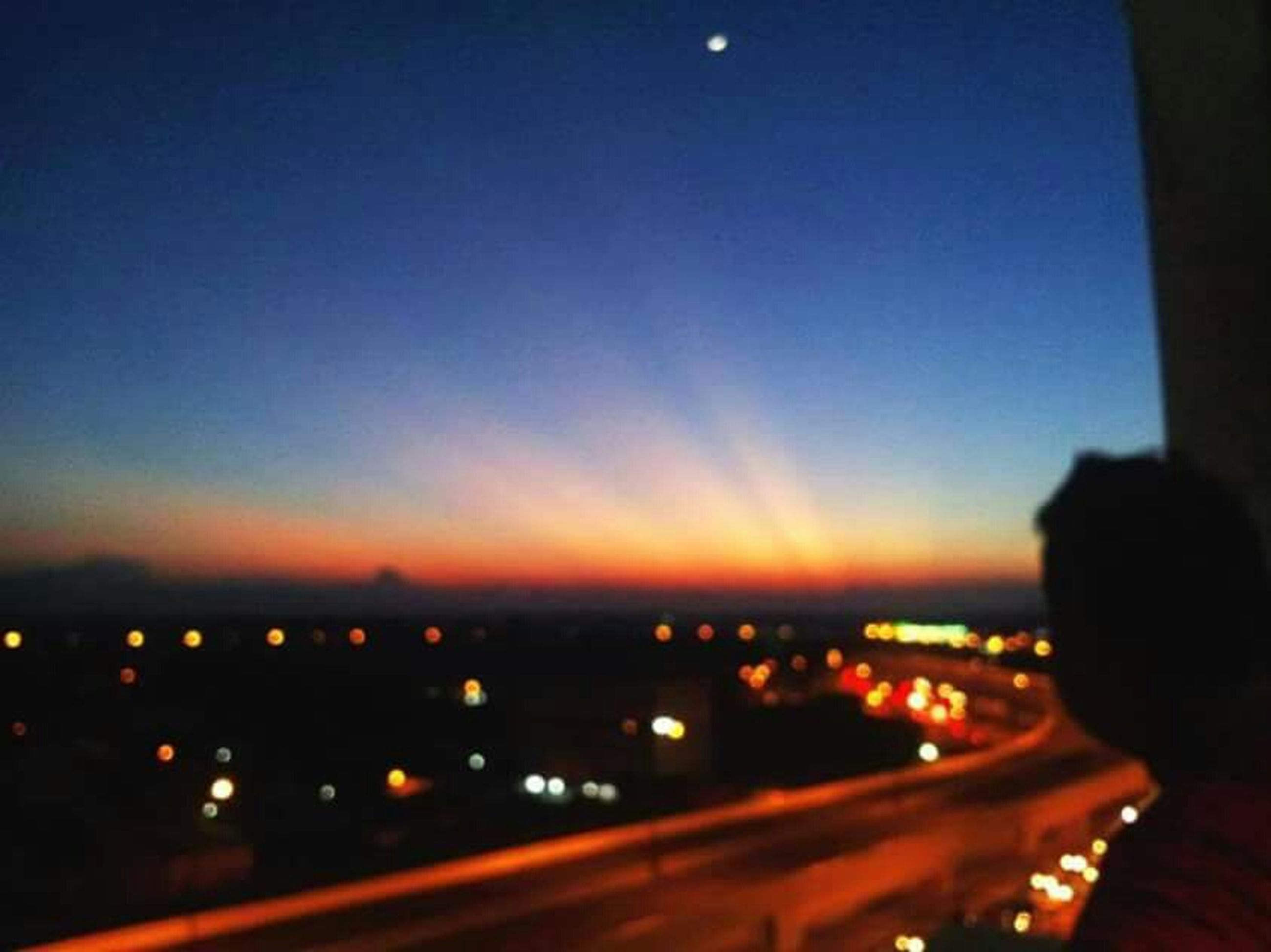 illuminated, night, transportation, sky, dusk, city, clear sky, copy space, defocused, long exposure, light trail, sunset, light - natural phenomenon, light, blue, silhouette, road, dark, blurred motion, lighting equipment