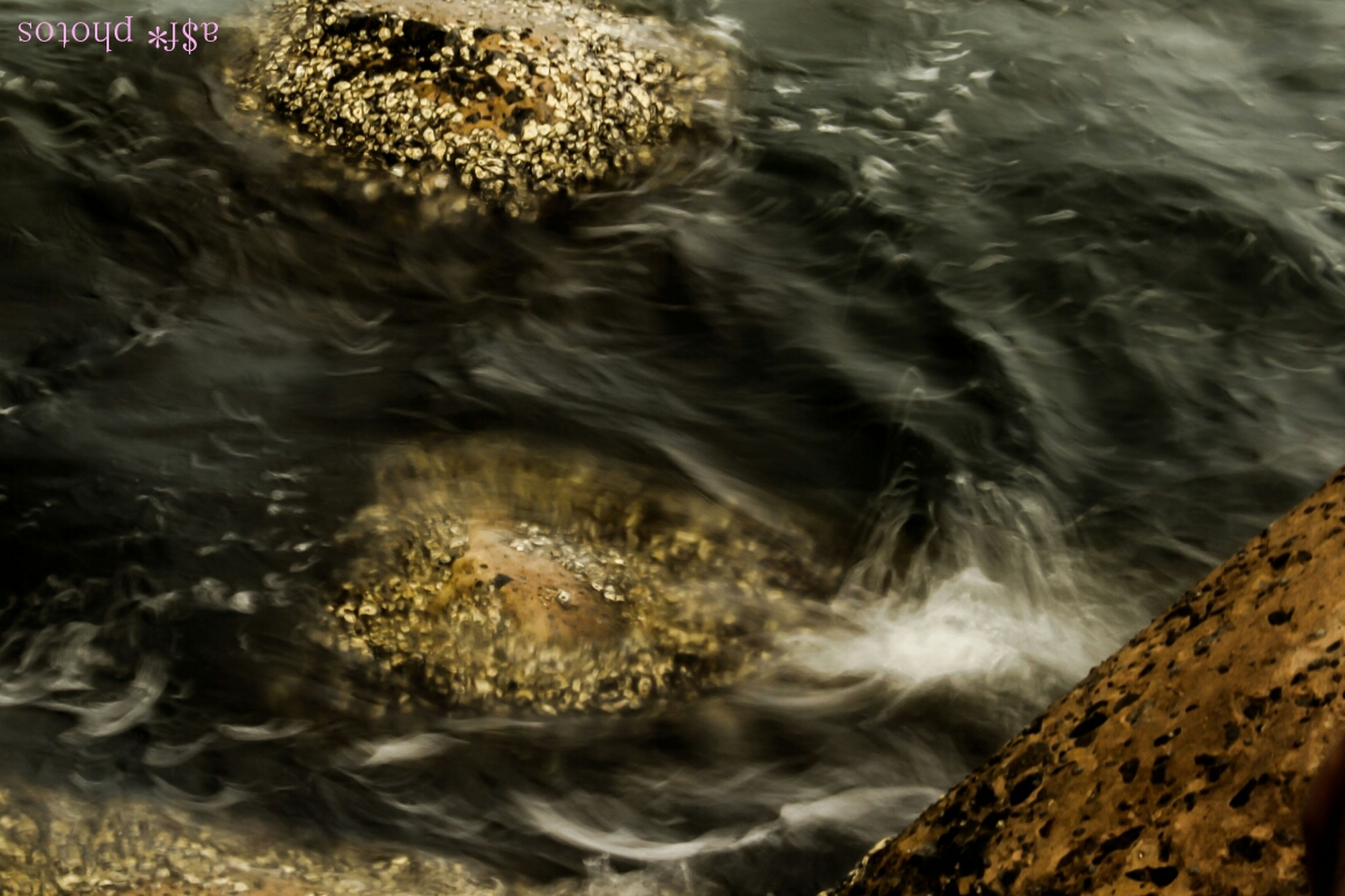 water, high angle view, surf, nature, rock - object, sea, motion, river, wave, flowing water, waterfront, outdoors, day, rippled, no people, beauty in nature, flowing, shore, splashing, stream