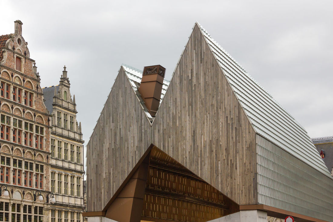 Ghetto New Market Hall by Robbrecht en Daem (Horton & Crow). Architecture Bold Building Exterior Glass - Material Light And Shadow Metal - Material Old And New Architecture Pattern Shape Textures And Surfaces Wood - Material