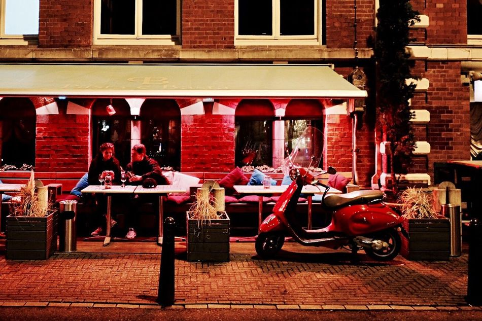 Building Exterior Architecture Red City Built Structure Outdoors Transportation Illuminated No People Outdoor Restaurant City At Night City Street Amsterdam Light And Shadow Fujifilm X-pro2 Scooter Nightlife The City Light Urban Exploration Night Lights