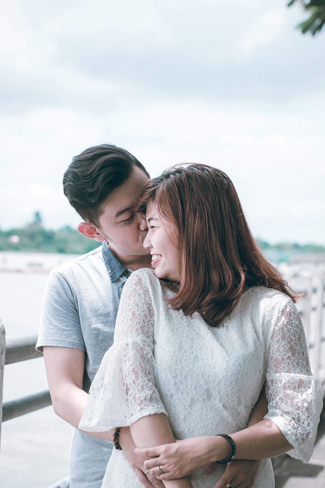 Eyeemnew Togetherness Love Romance Embracing Heterosexual Couple Young Women Bonding Young Adult Casual Clothing Couple - Relationship Happiness Day Women Adult Affectionate Smiling Adults Only Men Outdoors