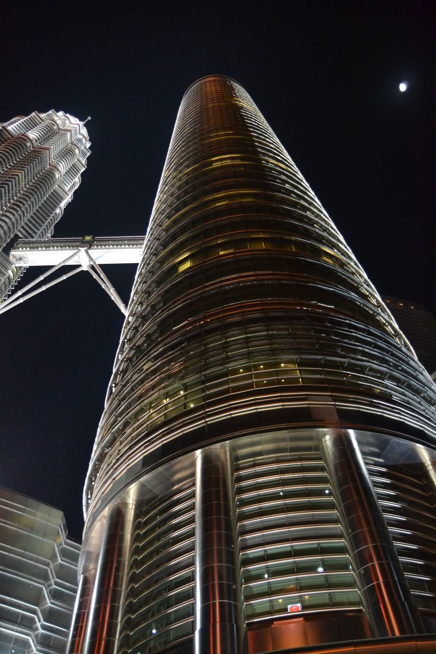 low angle view, architecture, building exterior, night, built structure, modern, no people, skyscraper, outdoors, city, illuminated, sky