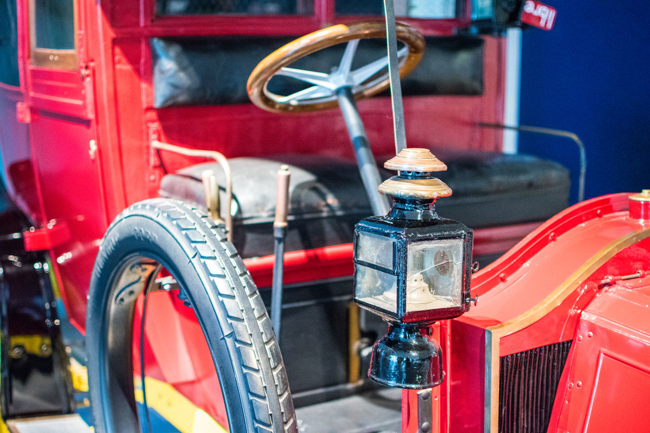 mode of transport, transportation, red, land vehicle, no people, focus on foreground, wheel, close-up, day, outdoors, nautical vessel, fire engine