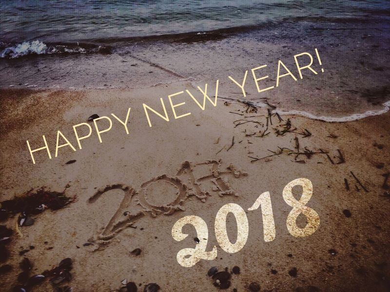 Wishing all my ee friends a blessed and Joyful New Year! There are waiting 12 new chapters with 365 new chances!!! New Year 2018 Text Western Script Communication Written Handwriting  Message Capital Letter Beach Single Word Outdoors No People Day Welcome Sign Sand Nature