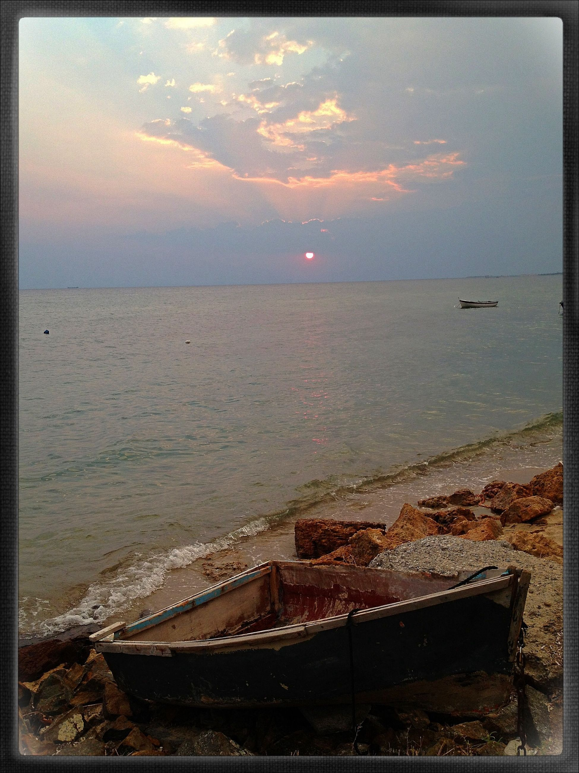 sea, transfer print, water, horizon over water, sky, auto post production filter, sunset, scenics, tranquil scene, tranquility, beauty in nature, nature, cloud - sky, built structure, idyllic, beach, nautical vessel, high angle view, shore, outdoors