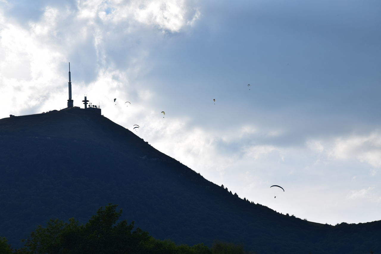puy de dome paragliding Architecture Auvergne Beauty In Nature Cloud Cloud - Sky Cloudy Day Flight Flying High Section Low Angle View Mountain Mountain Range Nature No People Outdoors Outline Paragliding Puy De Dôme Scenics Silhouette Sky Solitude Tranquil Scene Tranquility