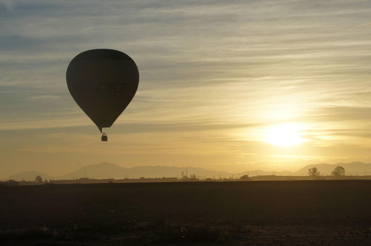Hot Air Balloon Against Sky During Sunrise