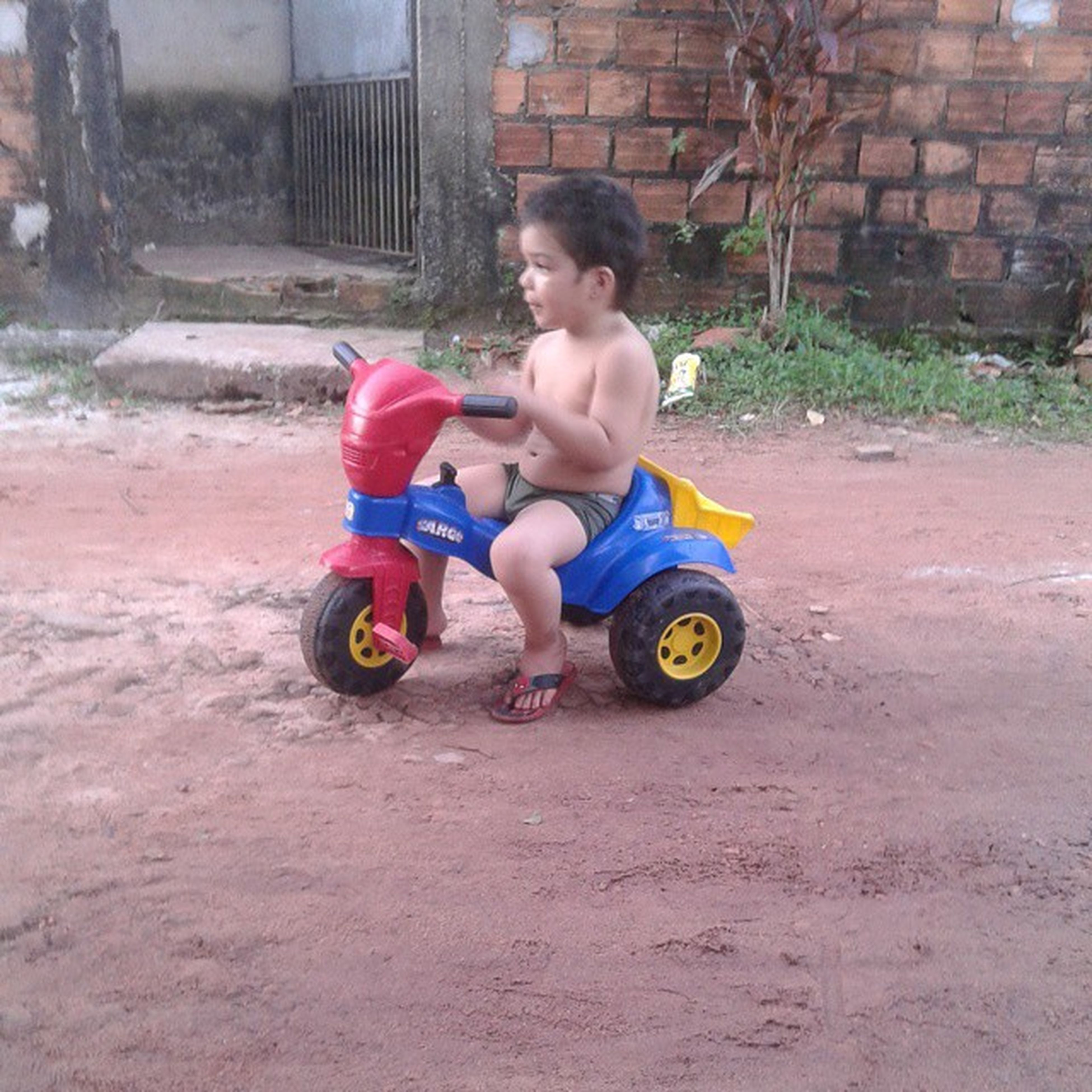 childhood, full length, elementary age, boys, lifestyles, person, leisure activity, casual clothing, girls, innocence, playful, playing, land vehicle, bicycle, cute, transportation, mode of transport, toy