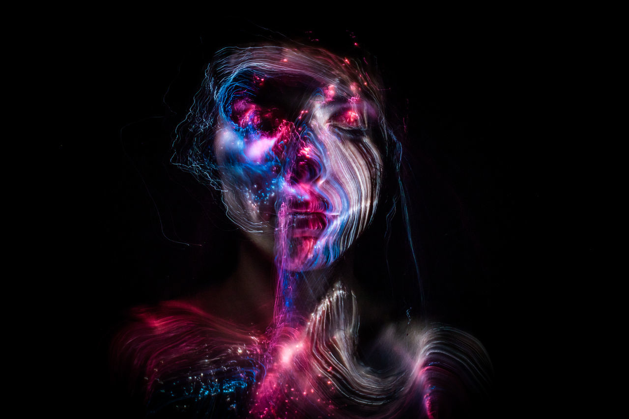 some lightpainting with a friend Alien Black Background Creepy Darkness Electricity  Fear Female Fiber Optic Cable Freaky Futuristic Headshot Light Painting One Person People Portrait Portrait Of A Woman Relaxed Science Fiction Space