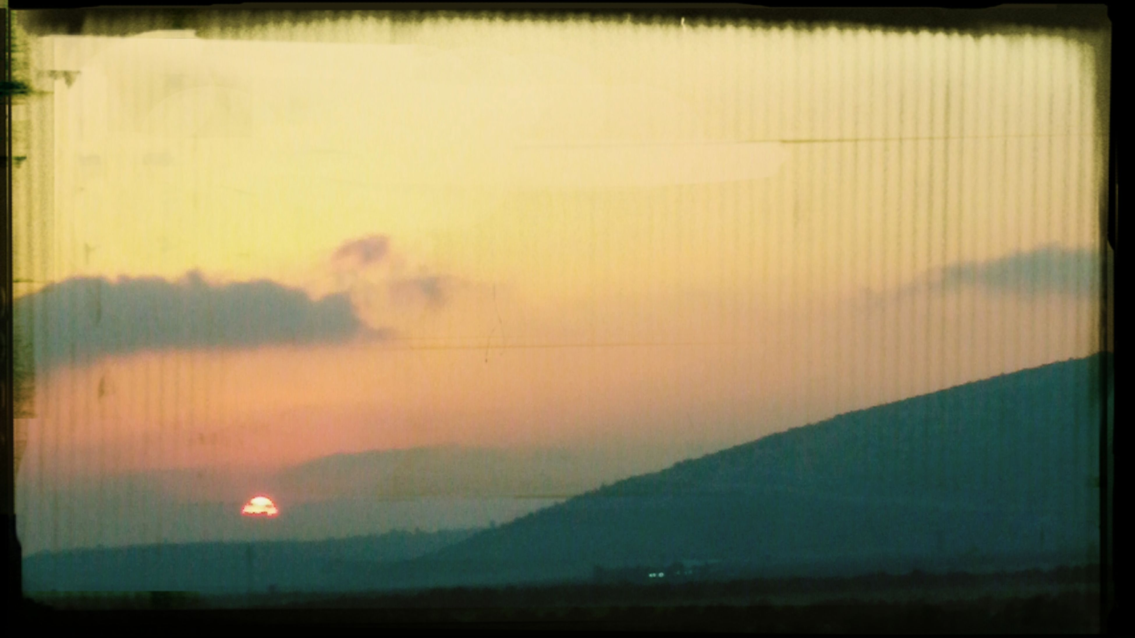 transfer print, sunset, auto post production filter, scenics, tranquil scene, sky, tranquility, silhouette, beauty in nature, nature, dusk, landscape, idyllic, cloud - sky, mountain, orange color, dark, outdoors, sun, weather