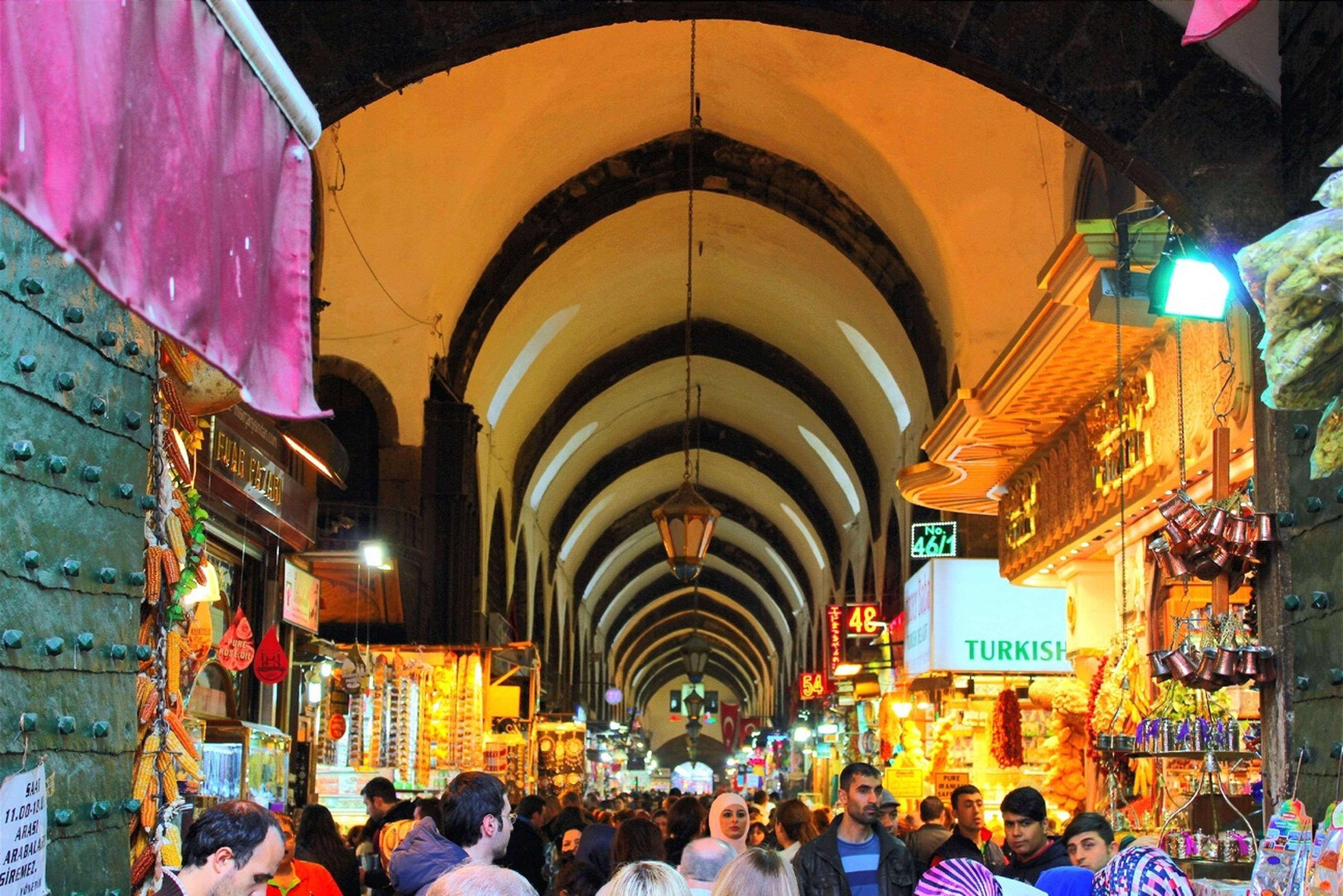 large group of people, illuminated, person, men, lifestyles, crowd, leisure activity, indoors, architecture, built structure, night, lighting equipment, mixed age range, walking, city life, market, arts culture and entertainment, celebration, ceiling