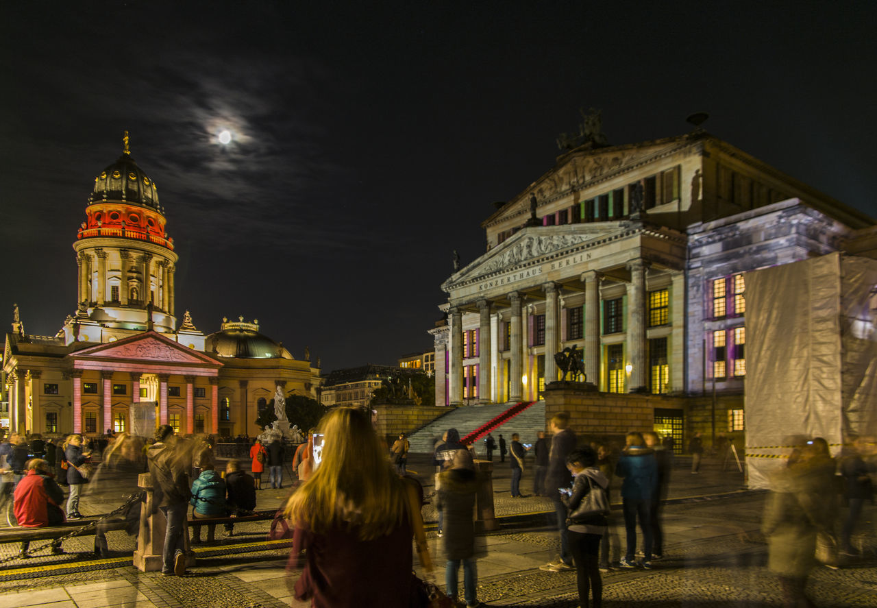 architecture, building exterior, built structure, night, illuminated, sky, real people, large group of people, men, city, women, outdoors, lifestyles, people