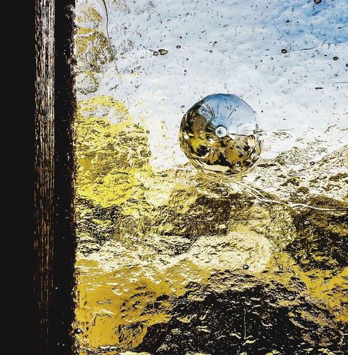 Crinkled future abstract cracked plastic No People Gold Colored Water Yellow Day Outdoors Close-up Nature Pattern Backgrounds Window Hole Broken Pellets Circle Psychological Outside Outside My Window Bullet Holes Watercolor
