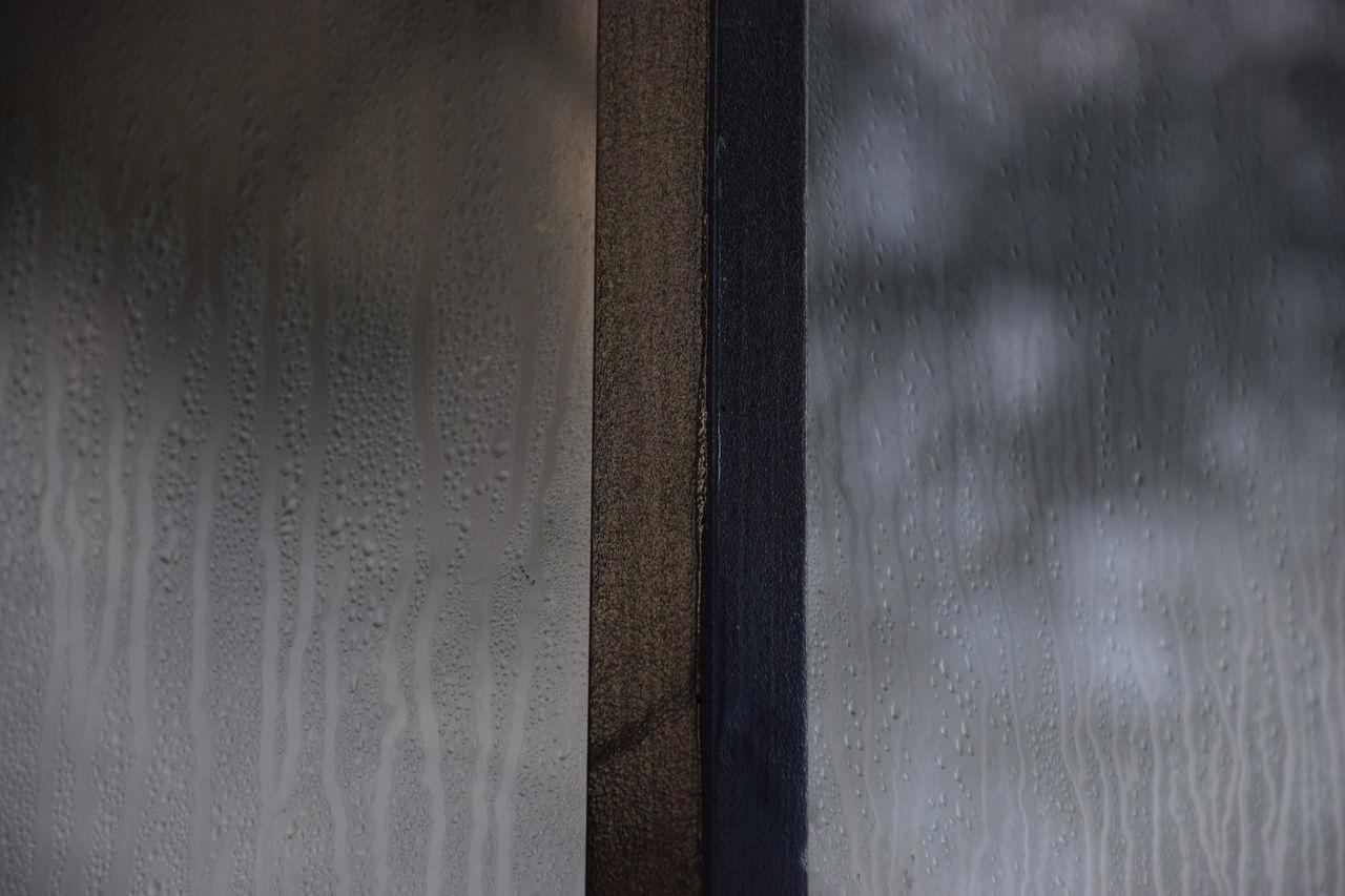 Full Frame Shot Of Condensed Glass