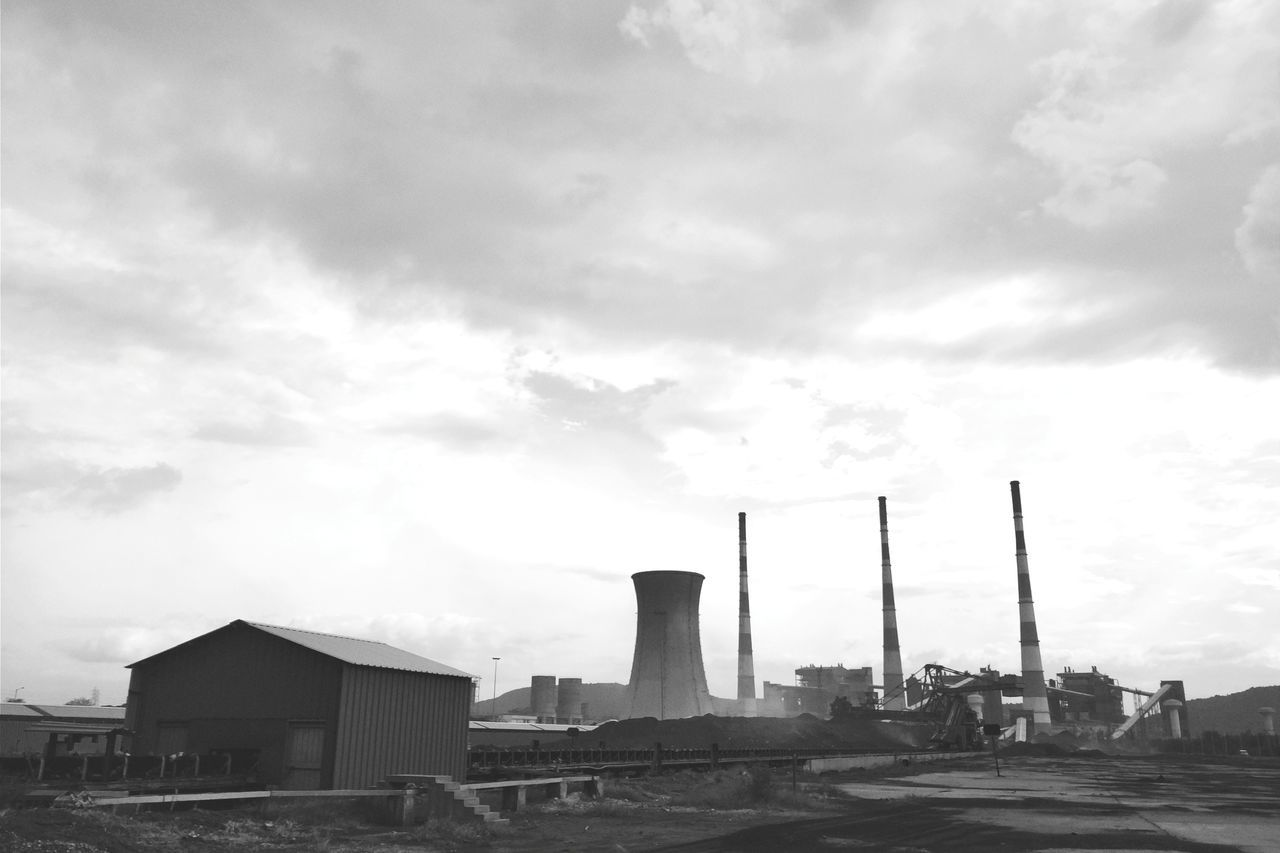 Industry Cloud - Sky Business Finance And Industry Factory Social Issues Day Built Structure Outdoors Black & White Monochrome Blackandwhite Industry Architecture Landscape_Collection No People Smoke Stack Sky Water Gas Building Exterior Oil Pump