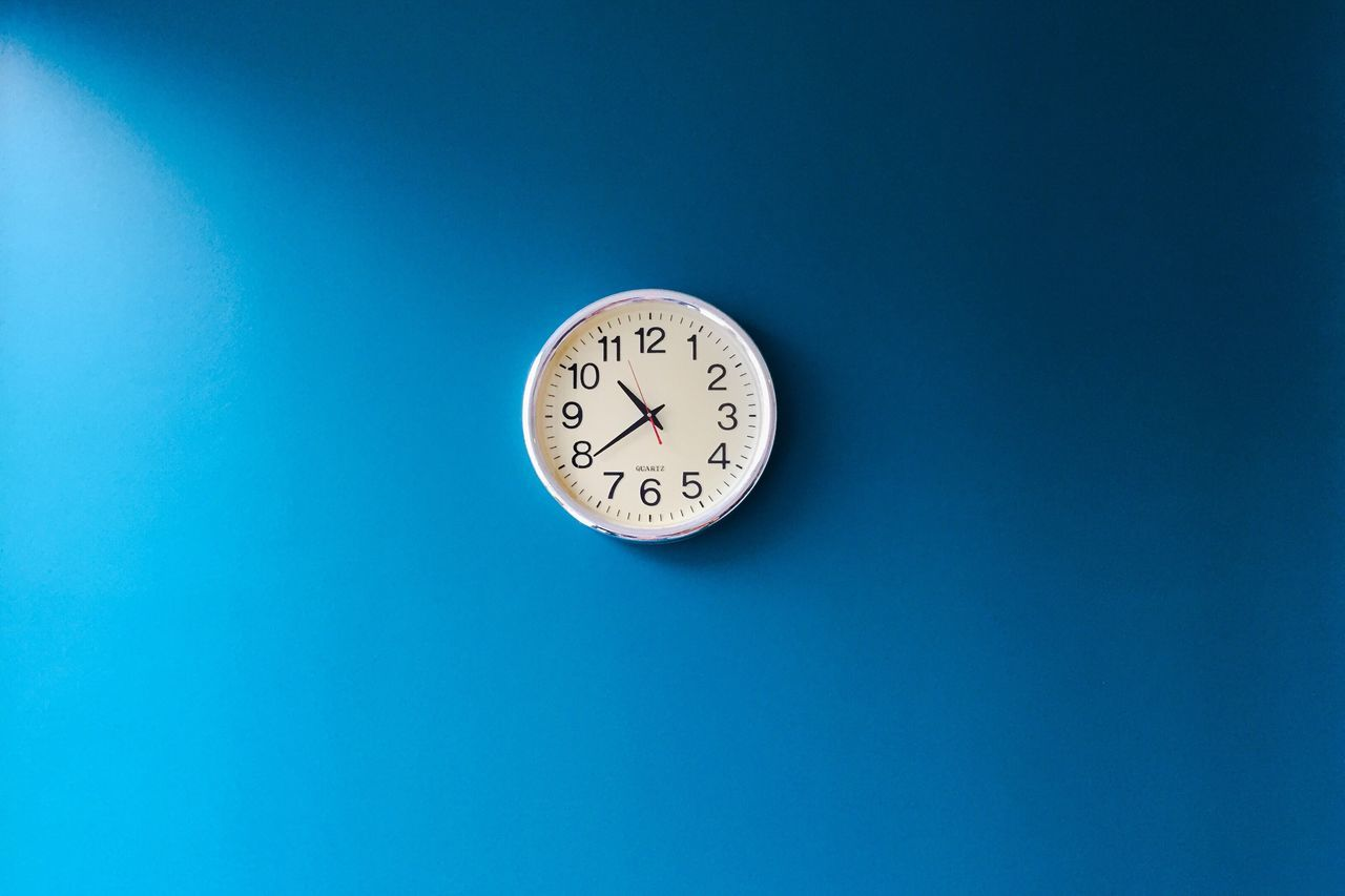 The Color of Business time clock Low angle view blue Copy Space accuracy number clock face Circle round geometric shape no people Office Morning light and shadow Working precision backgrounds