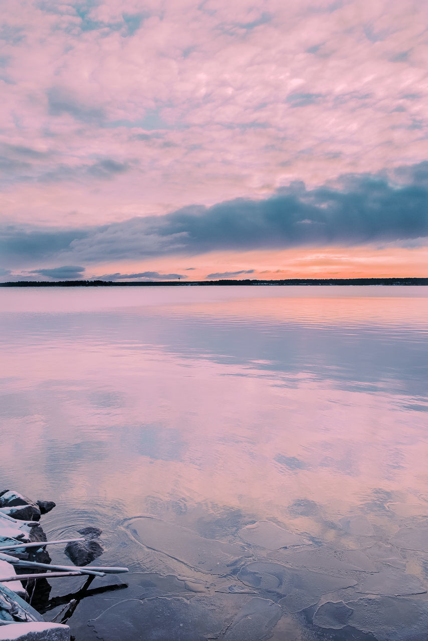 Scenic View Of Lake Against Sky At Sunset During Winter