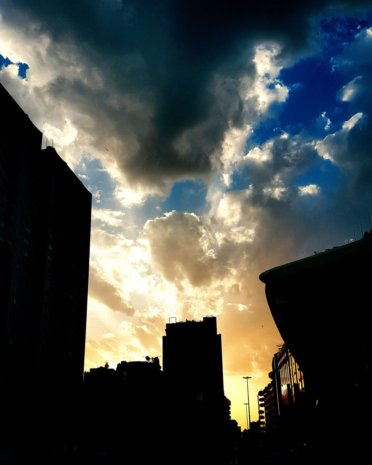 Sky Cloud - Sky Skyscraper Building Exterior No People City Sunset Low Angle View Dramatic Sky Outdoors Nature Urban Skyline Beauty In Nature Cityscape Architecture Day Silhouette PhonePhotography Weather Photography Sunlight Built Structure EyeEmNewHere