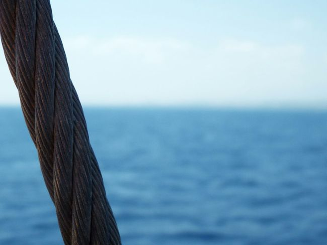 Rope On A Boat Blue Water Blue Sky Blue Wave Sea Mediterranean Sea Travel Photography Boat Trip Focus On Foreground