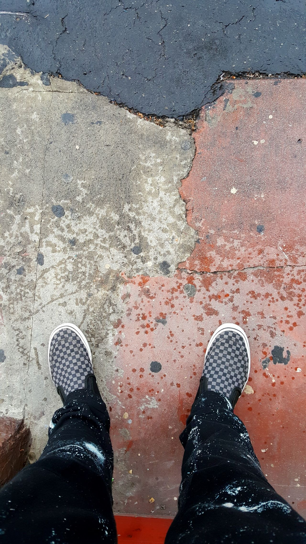 Low Section Real People Human Leg Cracked Concrete Contrast Natural Lightning Soft Lighting No Filter Offthewall High Angle View Splatters Standing Shoe Lifestyles Outdoors Day Checkered Pattern Human Body Part Road Close-up Full Frame Urban Landscape Joggerpants Lifeontheroad Flying High