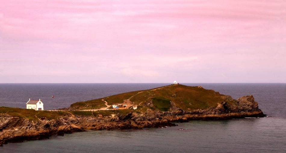 Evening light at Towan Head, the headland at Newquay Bay in Cornwall England Coastline Landscape Evening Light Peaceful View Pink Sky Towan Headland Travel Photography Architecture Beauty In Nature Building Exterior Built Structure Day Headland Horizon Over Water Nature No People Outdoors Scenics Sea Sky Tranquility Travel Destinations Water Waterfront