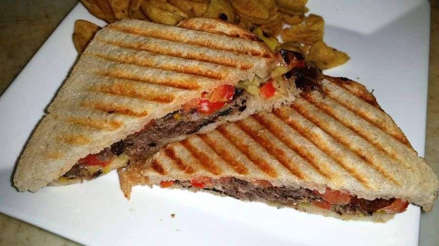 Short rib panini with peppers and leeks. Chef Cheflife Food Foodphotography Food Photography Foodgasm FoodGASMfest