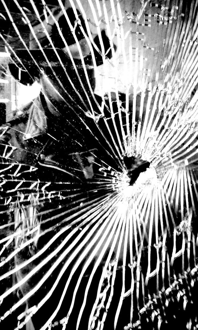 We may look at our glass and assume it was broken from the outside in..Broken by another...Struck with the brute force to make endless mirrors...a shattered carapice to show a hollow inner shell cracked under pressure ..A myriad of shining sources..Jagged....Created by fissures and chips..... The mistake is lacking the realization of pressure breaking from the core to the outer shield...A crack in the heart which petrified the mind until it burst...Many faces and perspectives show shards gleaming through the blackest shadow...hanging on to any slight refraction of light... We find our broken inner self reflecting what we see and we make sure to be sharp. The break was so quick and so are we to cut the others that touch our fractured soul... Clinging and dwelling like a mosaic that spuriosly wishes to be sanded down to be made whole and smoothed over time... yet.... We were never whole... Made of many makers..Tempered by many heated experiences..Puzzled with too many pieces- Serrated smithereens ready to be governed by the tongue of another who breathes part of us into their mouth - forever guided by a passionate bloody kiss. Light And Shadow Human Condition Shadows Reflection_collection Blancoynegro Eye4photography  Blackandwhite Photography EyeEm Best Edits Notes From The Underground Blackandwhite Noiretblanc Darkart Self Portrait Black And White Collection  Bnw Bnw_collection Faces Of EyeEm Art, Drawing, Creativity Love Mobilephotography That's Me STAY HUMAN 💯 EyeEm Best Shots - Black + White Dark Dark Photography