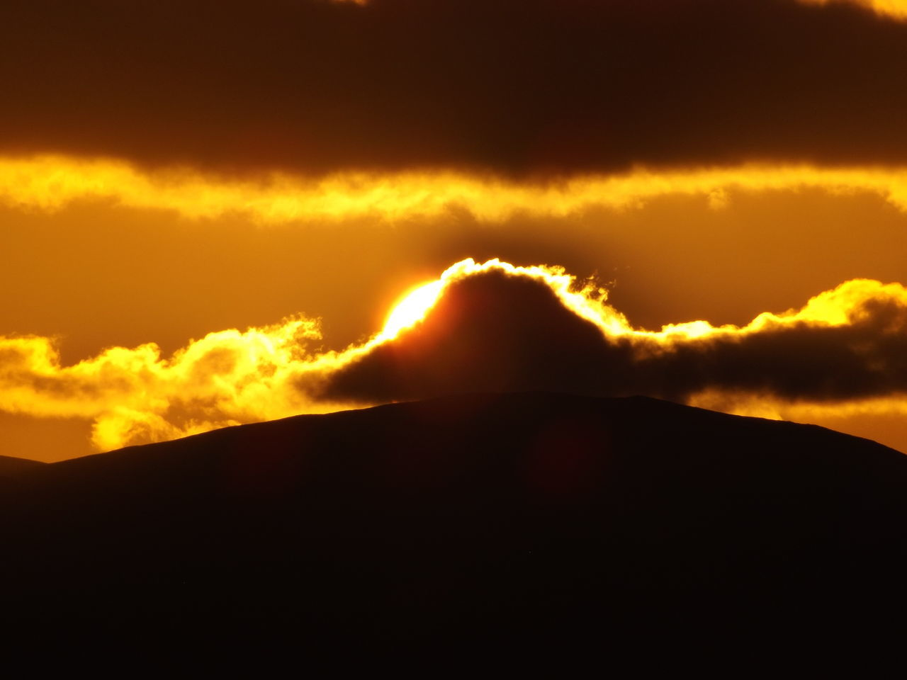 Beauty In Nature Black Close-up Cloud Clouds And Sky Gold Heat - Temperature Isle Of Arran  Moment Mountain Nature No People Orange Outdoors Power In Nature Romantic Scenics Scotland Silhouette Sky Sun Sunset Sunset Silhouettes Sunset_collection