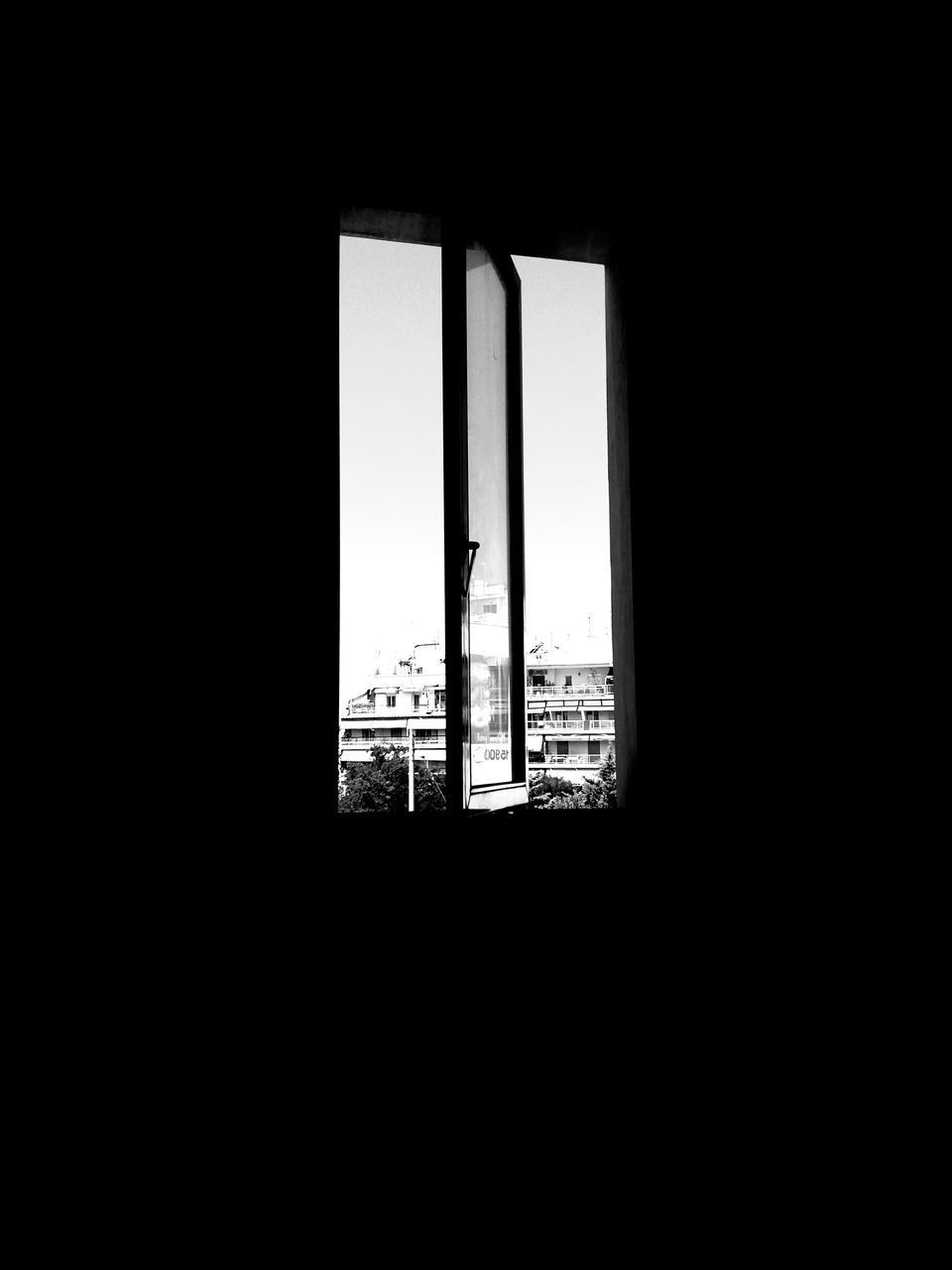 window, indoors, architecture, dark, built structure, no people, day, building exterior, skyscraper, sky
