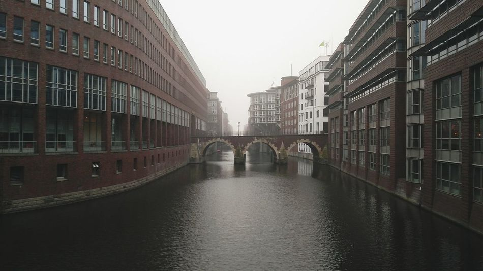 Hamburg City Center. · Germany 040 Hh Hamburgmeineperle Old Town Architecture City Urban Landscape Building Exterior Outdoors Water Channel Bridge Bridges Klinker Fog Gray Sky Gray Day