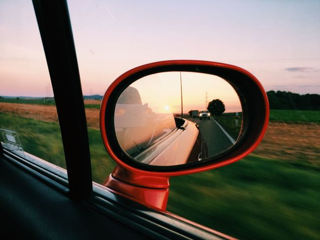 Transportation Transparent Side-view Mirror Mode Of Transport Car Person Vehicle Interior Land Vehicle Sunset Landscape Nature Day Close-up Outdoors Vehicle Mirror Traveling Lifestyles Roadtrip Red Road