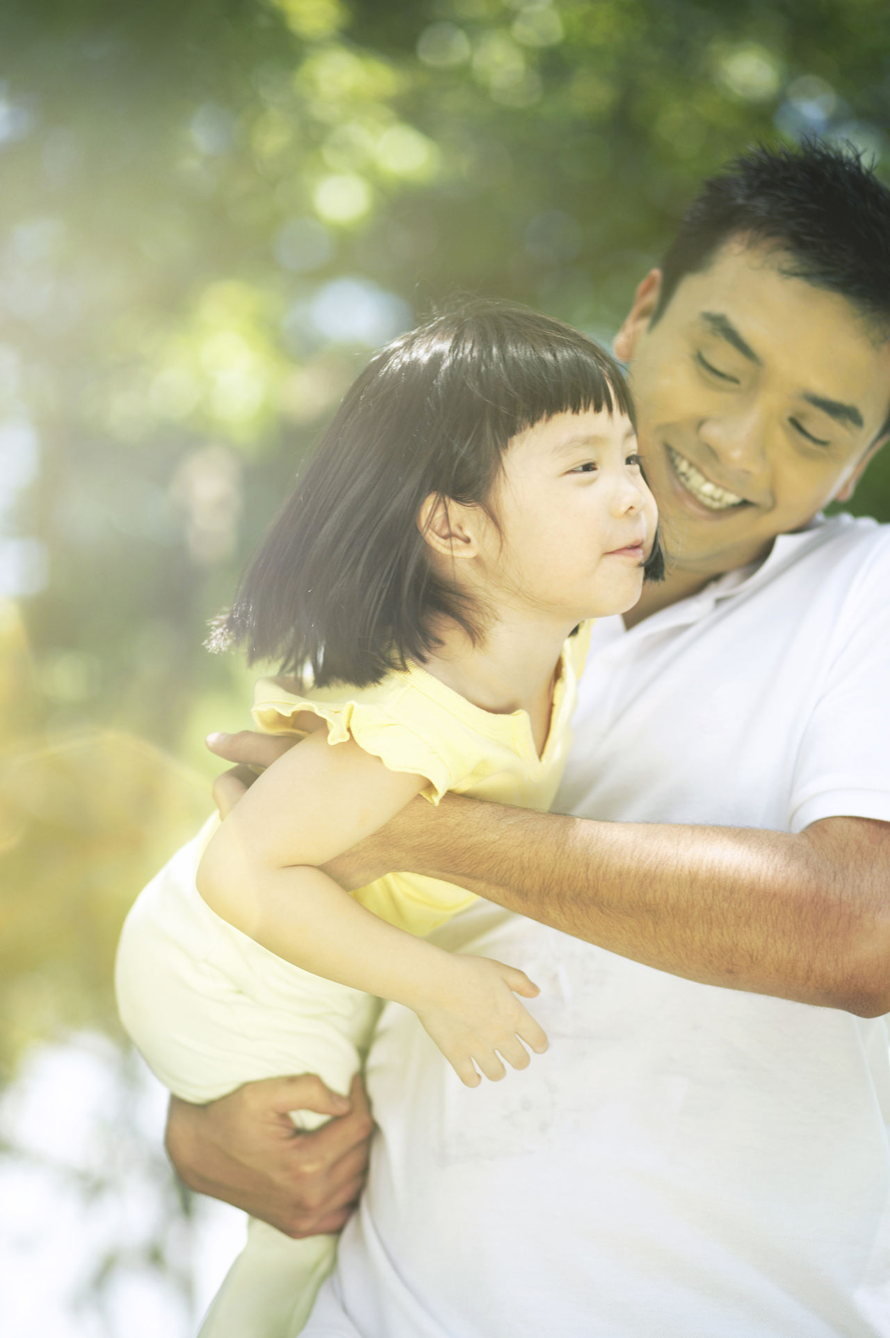 Bonding Carry Casual Clothing Childhood Daughter Day Embracing Family With One Child Father Father And Daughter Free Time Happiness Leisure Activity Lifestyles Love Outdoor Outdoors Real People Smiling Swing Togetherness Tree Weekend Activities Young Adult
