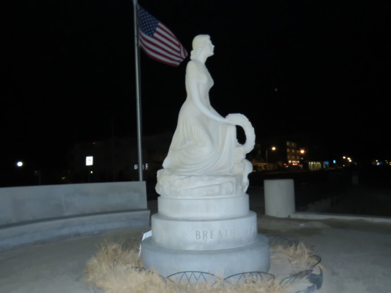 Hampton Beach statue Flag Hampton Beach Memorial Site Men Lost At Sea Night Pics No People Outdoors Patriotism Stars And Stripes Forever Statue Of A Woman Us Woman Waiting Wreath Of Flowers