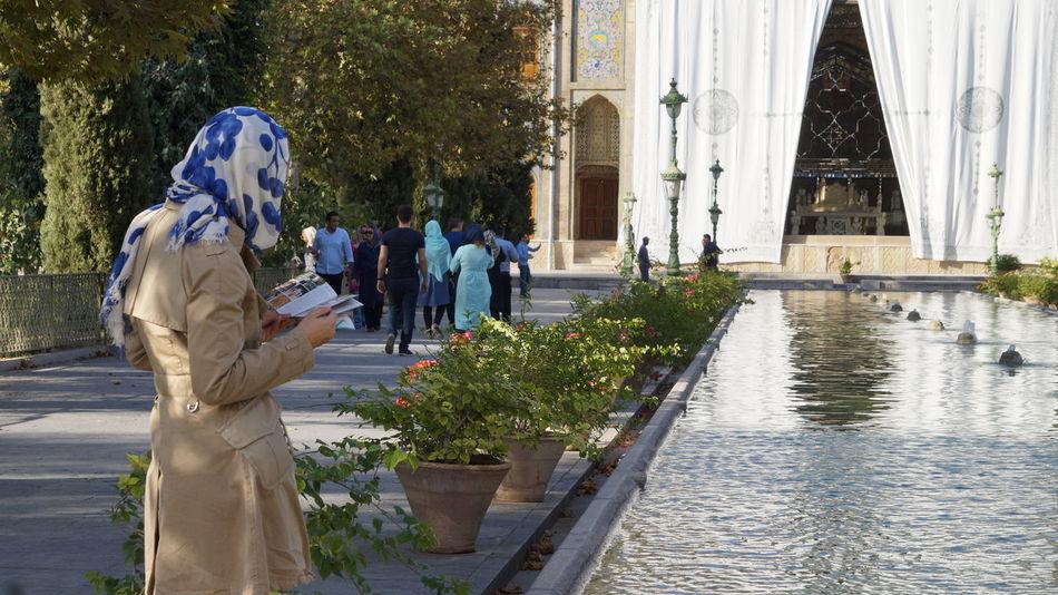 Women reading tourist guide at Golestan Palace, Tehran Architecture Architecture Building Exterior Day Golestan Palace Iran Islamic Architecture Outdoors Palace People Tourist Tourist Guide Tree Women Public Places Women Around The World